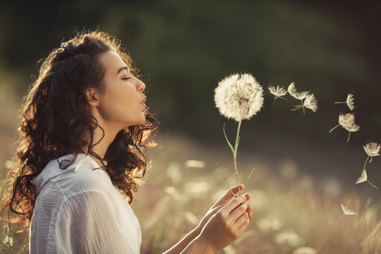 bigstock-Beautiful-Young-Woman-Sitting-261520120